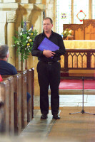 Director John Adams during a concert in Ilmington